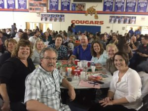 Happy Cougar supporters on Trivia Night